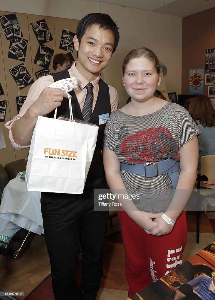 Actor Osric Chau poses with a patient at 'Fun Size' Special Screening At Children's Hospital Los Angeles at Childrens Hospital Of Los Angeles on...