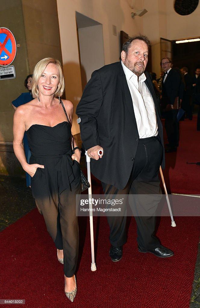 Actor Ottfried Fischer and his partner Simone Brandlmeier attend the Bernhard Wicki Award (Friedenspreis des Deutschen Films) during the Munich Film Festival 2016 at Cuvilles Theatre on June 30, 2016 in Munich, Germany.