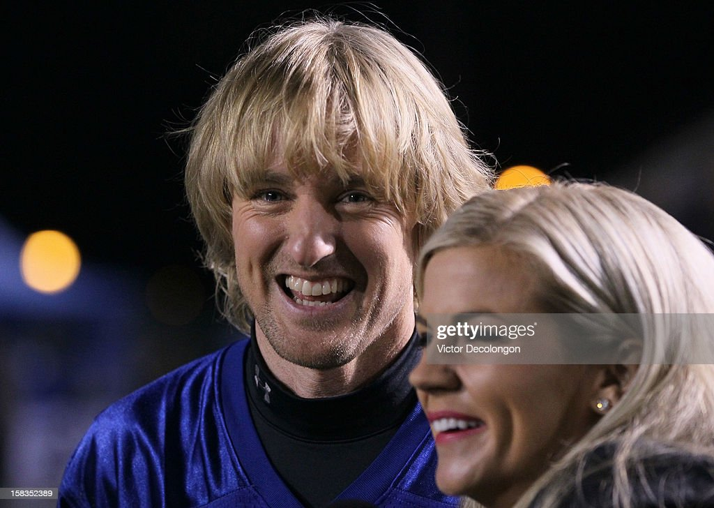 Actor Owen Wilson and ESPN Sportscaster Samantha Steele share a laugh during an interview on the sidelines during the Got Your 6 And Pat Tillman Foundation benefit game on December 13, 2012 in Norwalk, California.