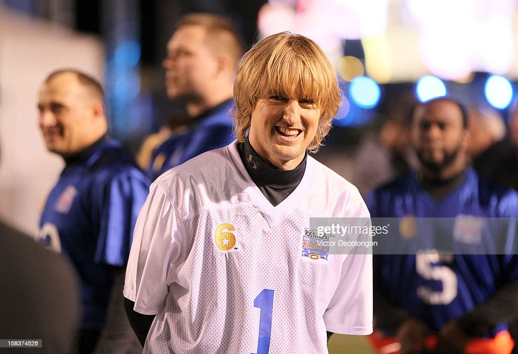 Actor Owen Wilson of Team Freedom laughs from the sidelines after switching from Team Liberty to Team Freedom during the Got Your 6 And Pat Tillman Foundation Benefit game on December 13, 2012 in Norwalk, California.