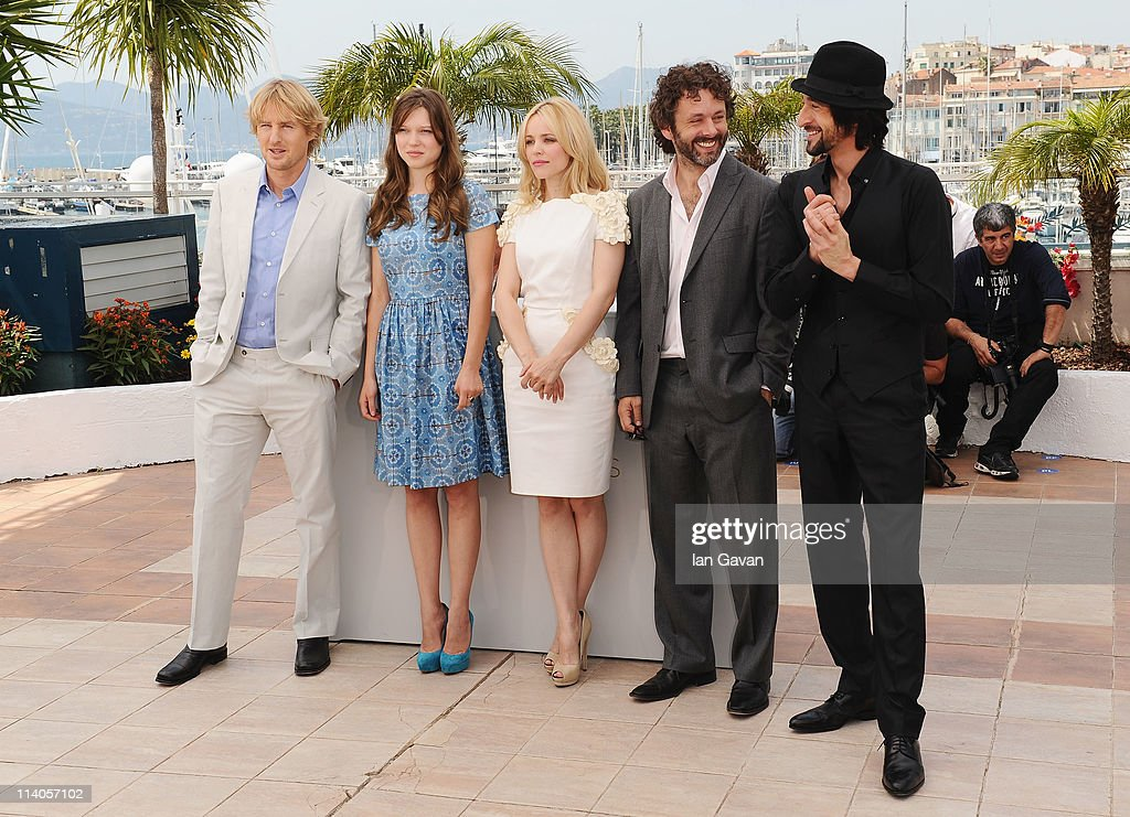 Actor Owen Wilson with actresses Lea Seydoux, Rachel McAdams and actors Michael Sheen, Adrien Brody attend the 'Midnight In Paris' photocall at the Palais des Festivals during the 64th Cannes Film Festival on May 11, 2011 in Cannes, France.