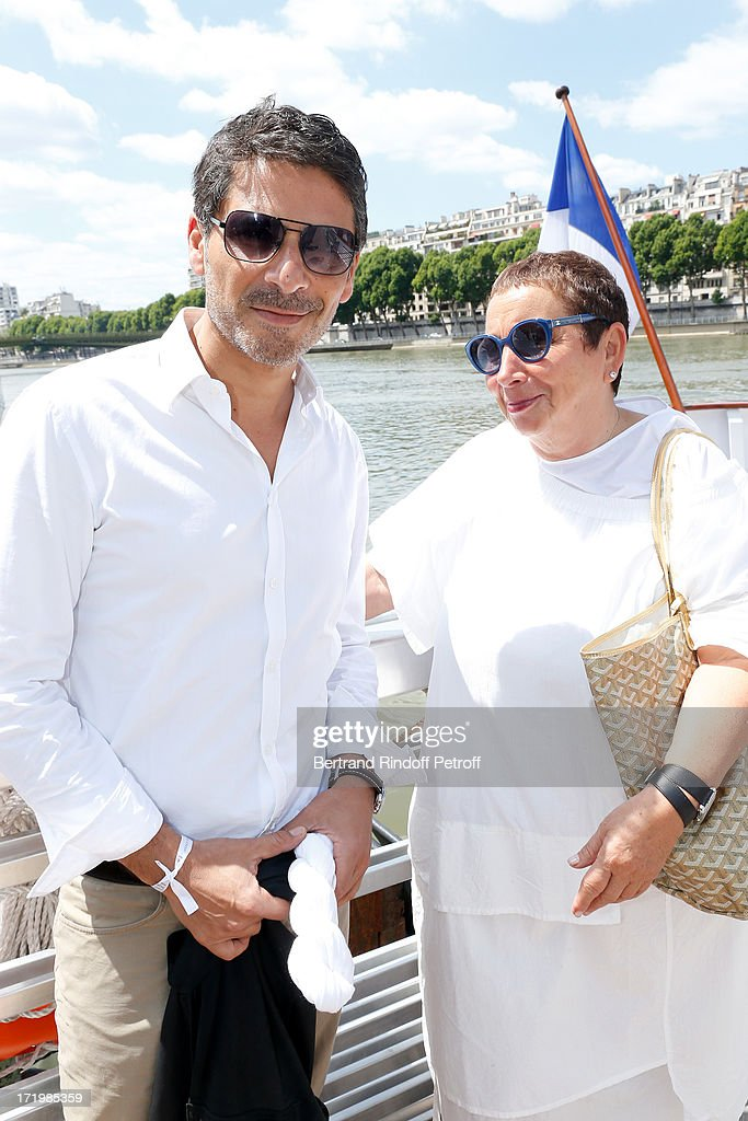 Actor Pascal Elbe and owner of 'La Petite Maison De Nicole' Nicole Rubi who made the Buffet attend 'Brunch Blanc' hosted by Groupe Barriere for Sodexho on June 30, 2013 in Paris, France.
