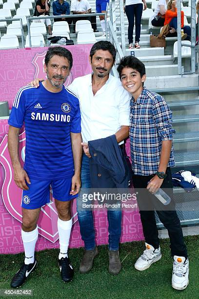 Actor Pascal Elbe and TV Director Serge Khalfon attend the Football match for the benefit of the association 'Plus fort la vie' at Stade Jean Bouin...