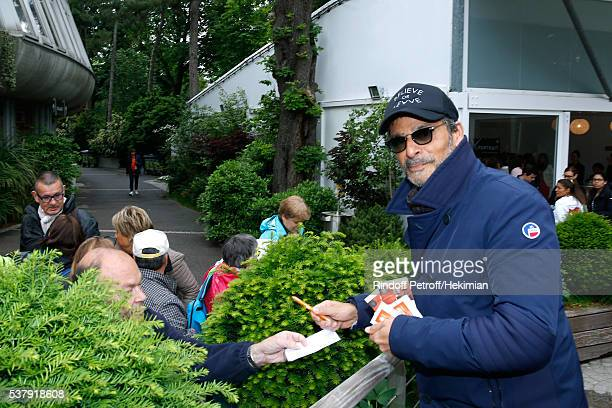 Actor Pascal Elbe signs autographs during Day Thirteen of the 2016 French Tennis Open at Roland Garros on June 3 2016 in Paris France