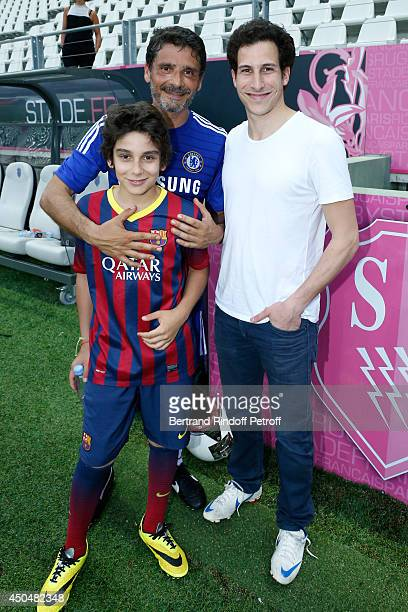 Actor Pascal Elbe with his sons Leo and Alexis attend the Football match for the benefit of the association 'Plus fort la vie' at Stade Jean Bouin on...