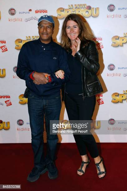Actor Pascal Legitimus and his wife Adriana Santini attend the 'Le Petit Spirou' Paris Premiere at Le Grand Rex on September 10 2017 in Paris France