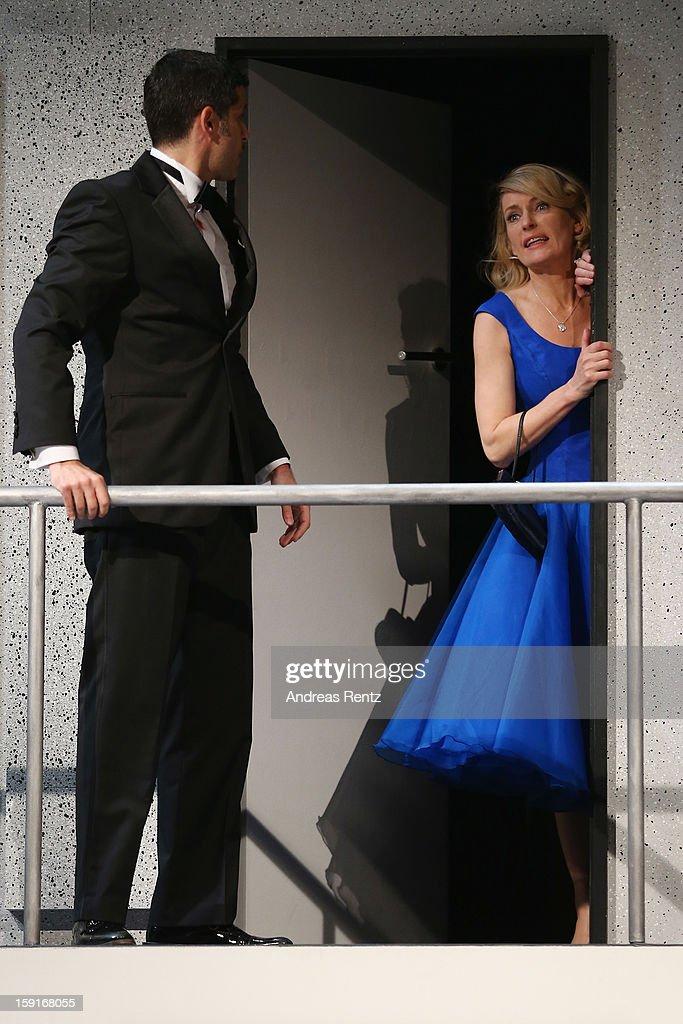 Actor Pasquale Aleardi and actress Maria Furtwaengler perform during the 'Geruechte...Geruechte...' photo rehearsal at Komoedie am Kurfuerstendamm Theater on January 9, 2013 in Berlin, Germany.