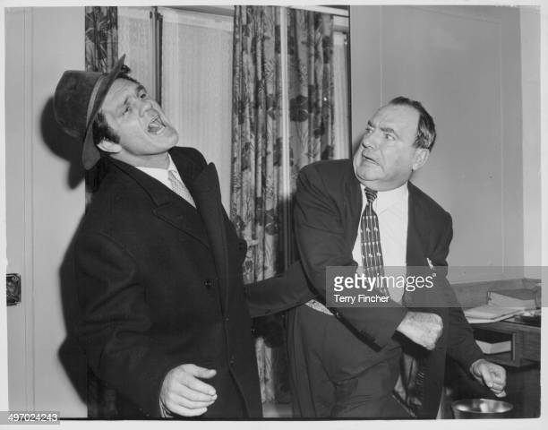 Actor Pat O'Brien and boxer Freddie Mills larking around as they make the film 'Kill Me Tomorrow' September 28th 1956