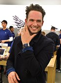 Actor Patrick Adams from the TV show 'Suits' tries on Apple Watch At The Apple Store at Eaton Centre Shopping Centre on April 24 2015 in Toronto...