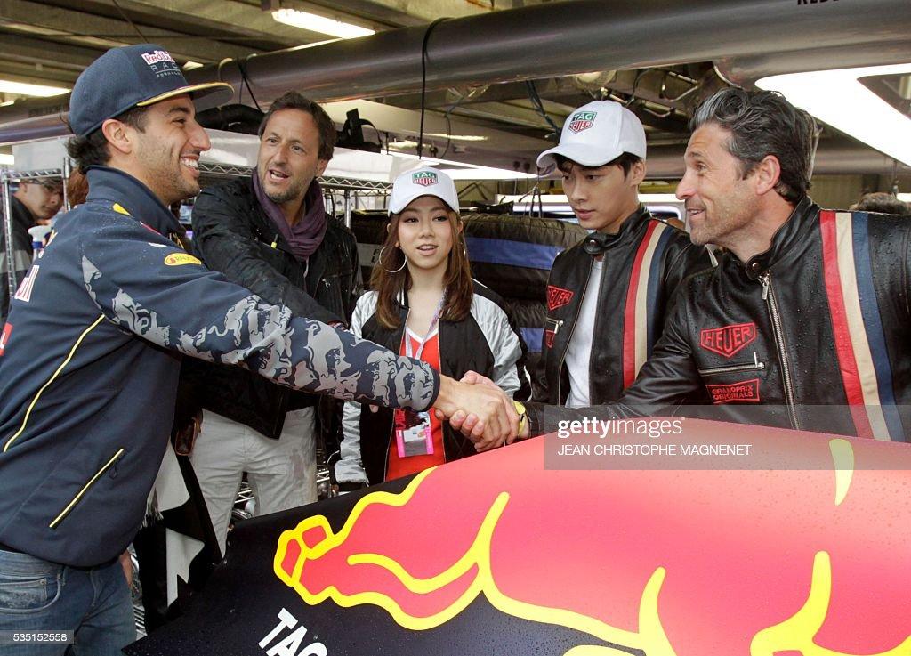 US actor Patrick Dempsey (R) meets Infiniti Red Bull Racing's Australian driver Daniel Ricciardo (L) at the Monaco street circuit, on May 29, 2016 in Monaco, ahead of the Monaco Formula 1 Grand Prix. / AFP / JEAN