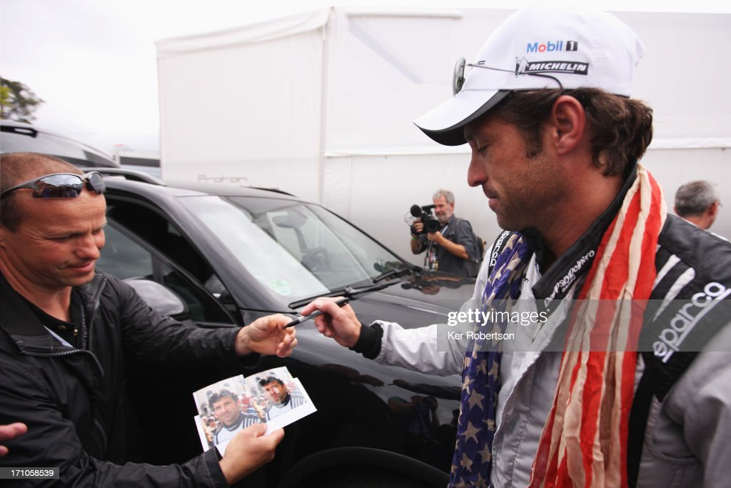 Actor <a gi-track='captionPersonalityLinkClicked' href=/galleries/search?phrase=Patrick+Dempsey&family=editorial&specificpeople=241264 ng-click='$event.stopPropagation()'>Patrick Dempsey</a> of the Dempsey Del Piero-Proton team is surrounded by fans in the paddock during previews for the Le Mans 24 Hour race at the Circuit de la Sarthe on June 21, 2013 in Le Mans, France.