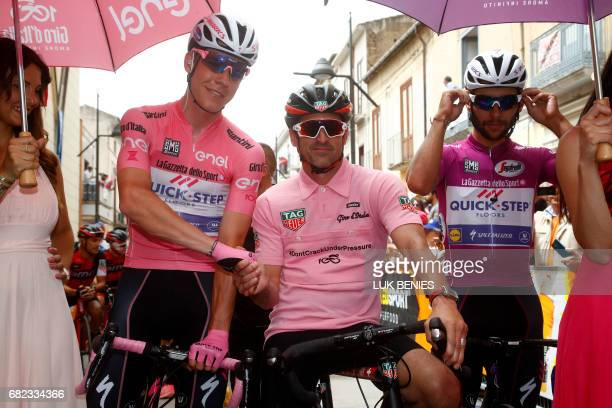 US actor Patrick Dempsey poses with Pink Jersey Luxembourg's Bob Jungels from team QuickStep and Colombia's Fernando Gaviria before the start of the...