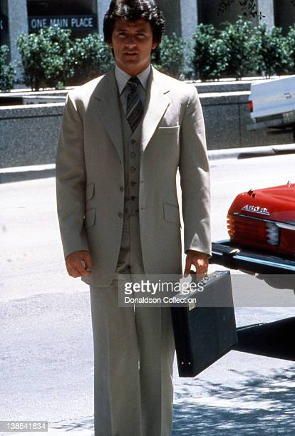 Actor Patrick Duffy poses for a portrait wearing a 3 piece suit and holding a brief case in circa 1980 in Los Angeles California