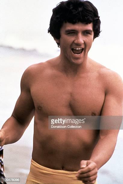 Actor Patrick Duffy runs on the beach in 1986 in Los Angeles California