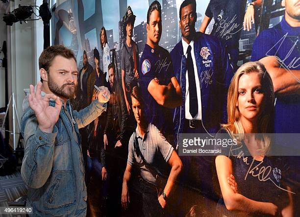 Actor Patrick John Flueger signs a poster as she attends a press junket for NBC's 'Chicago Fire' 'Chicago PD' and 'Chicago Med' at Cinespace Chicago...