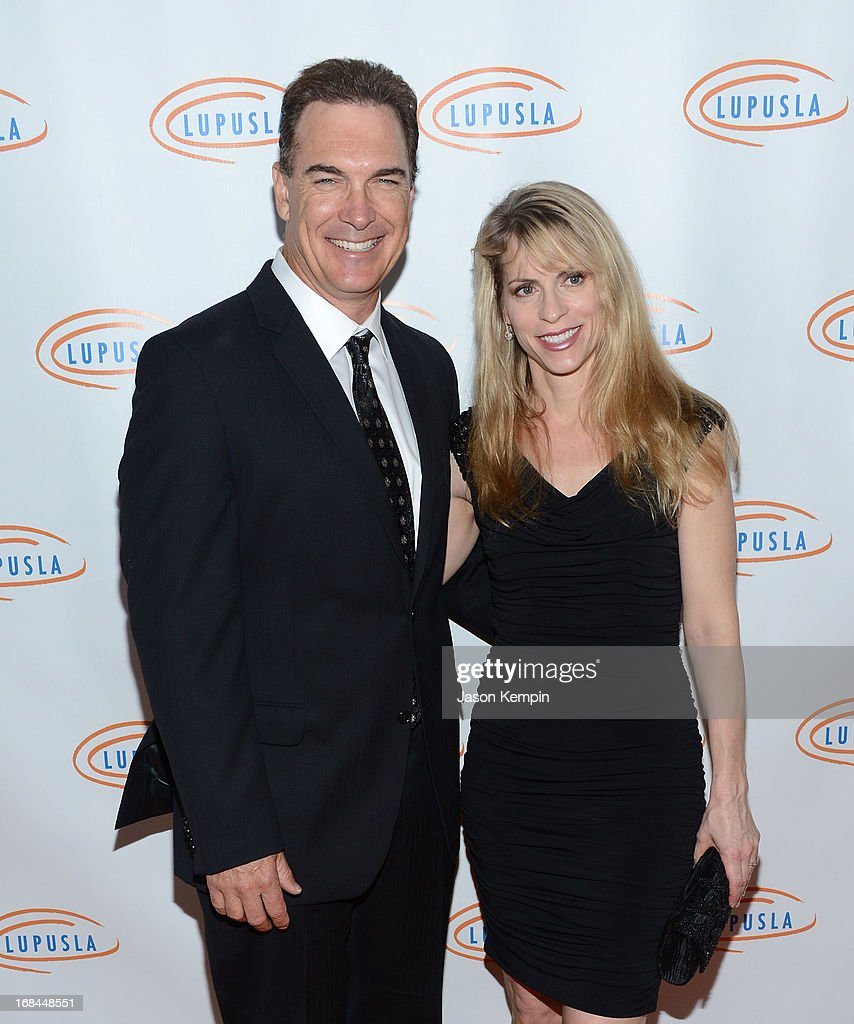 Actor <a gi-track='captionPersonalityLinkClicked' href=/galleries/search?phrase=Patrick+Warburton&family=editorial&specificpeople=228029 ng-click='$event.stopPropagation()'>Patrick Warburton</a> and Cathy Jennings attend the 13th Annual Lupus LA Orange Ball at the Beverly Wilshire Four Seasons Hotel on May 9, 2013 in Beverly Hills, California.