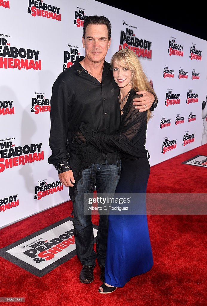 Actor Patrick Warburton and Cathy Jennings attend the premiere of Twentieth Century Fox and DreamWorks Animation's 'Mr Peabody Sherman' at Regency...