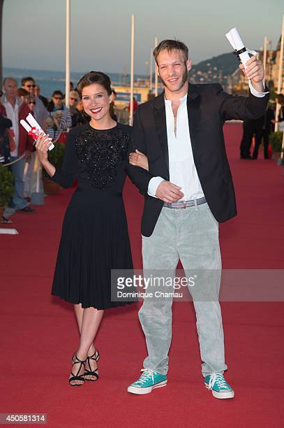 Actor Paul Hamy and actress Flore Bonaventura awarded ' prix de la jeunesse' during the 28th Cabourg Film Festival Day 3 on June 13 2014 in Cabourg...