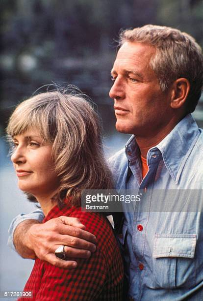 Actor Paul Newman and his wife actress Joanne Woodward shown on location for a television special Slide shows full length view of the two