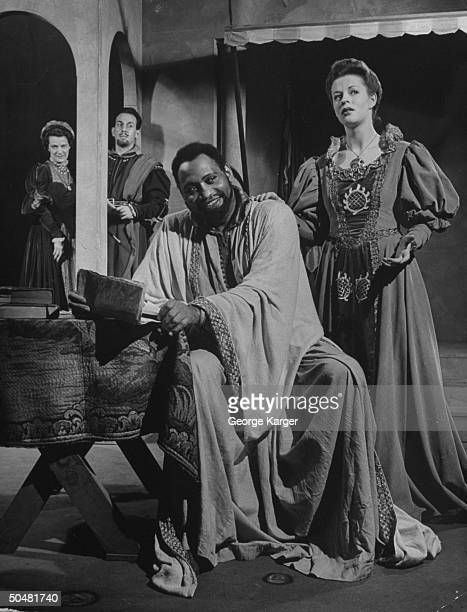 Actor Paul Robeson acting with Uta Hagen and Jose Ferrer in scene from Othello