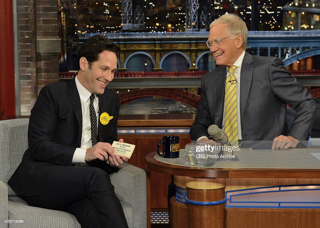 Actor <a gi-track='captionPersonalityLinkClicked' href=/galleries/search?phrase=Paul+Rudd&family=editorial&specificpeople=209014 ng-click='$event.stopPropagation()'>Paul Rudd</a>, shows off to Late Show host <a gi-track='captionPersonalityLinkClicked' href=/galleries/search?phrase=David+Letterman+-+Pr%C3%A9sentateur+de+t%C3%A9l%C3%A9vision&family=editorial&specificpeople=171322 ng-click='$event.stopPropagation()'>David Letterman</a>, his his original membership pin and membership card, that turns into a sponge when soaked in water, to the <a gi-track='captionPersonalityLinkClicked' href=/galleries/search?phrase=David+Letterman+-+Pr%C3%A9sentateur+de+t%C3%A9l%C3%A9vision&family=editorial&specificpeople=171322 ng-click='$event.stopPropagation()'>David Letterman</a> Fan Club during the 4/21/15 taping in New York.