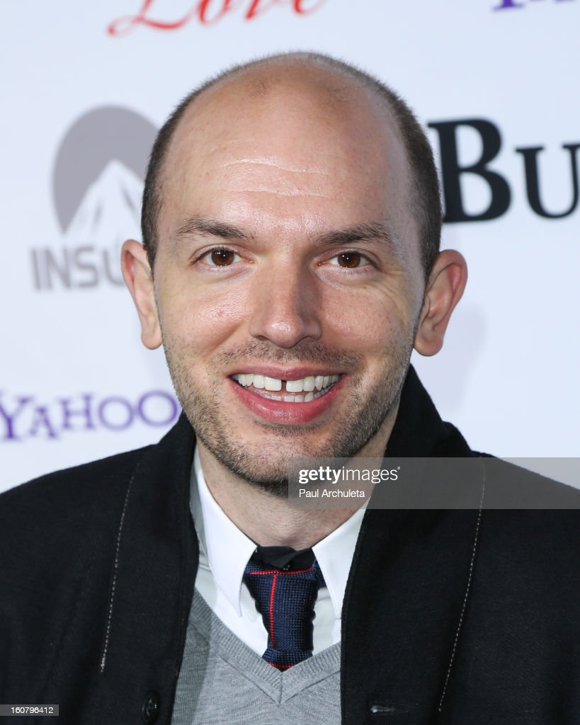 Actor <a gi-track='captionPersonalityLinkClicked' href=/galleries/search?phrase=Paul+Scheer&family=editorial&specificpeople=805513 ng-click='$event.stopPropagation()'>Paul Scheer</a> attends the 'Burning Love' Season 2 Los Angeles Premiere at Paramount Theater on the Paramount Studios lot on February 5, 2013 in Hollywood, California.