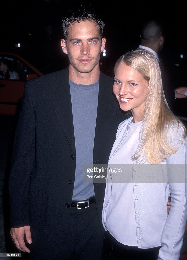 Actor Paul Walker and date Bliss Ellis attend the 'Pleasantville' Westwood Premiere on October 19, 1998 at the Mann National Theatre in Westwood, California.