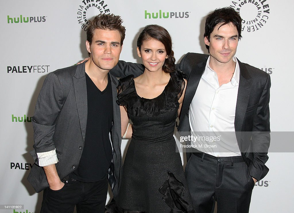 Actor <a gi-track='captionPersonalityLinkClicked' href=/galleries/search?phrase=Paul+Wesley&family=editorial&specificpeople=693176 ng-click='$event.stopPropagation()'>Paul Wesley</a>, actress <a gi-track='captionPersonalityLinkClicked' href=/galleries/search?phrase=Nina+Dobrev&family=editorial&specificpeople=4397485 ng-click='$event.stopPropagation()'>Nina Dobrev</a> and actor <a gi-track='captionPersonalityLinkClicked' href=/galleries/search?phrase=Ian+Somerhalder&family=editorial&specificpeople=614226 ng-click='$event.stopPropagation()'>Ian Somerhalder</a> attend The Paley Center For Media's PaleyFest 2012 Honoring 'The Vampire Diaries' at the Saban Theatre on March 10, 2012 in Beverly Hills, California.