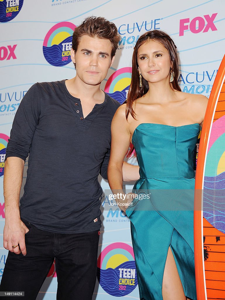 Actor <a gi-track='captionPersonalityLinkClicked' href=/galleries/search?phrase=Paul+Wesley&family=editorial&specificpeople=693176 ng-click='$event.stopPropagation()'>Paul Wesley</a> and actress <a gi-track='captionPersonalityLinkClicked' href=/galleries/search?phrase=Nina+Dobrev&family=editorial&specificpeople=4397485 ng-click='$event.stopPropagation()'>Nina Dobrev</a> pose in the press room at the 2012 Teen Choice Awards at Gibson Amphitheatre on July 22, 2012 in Universal City, California.