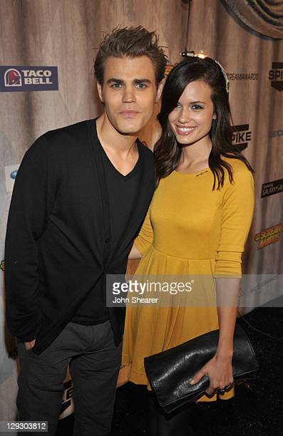 Actor Paul Wesley and actress Torrey DeVitto arrives at Spike TV's 'SCREAM 2011' awards held at the Universal Studios Backlot on October 15 2011 in...