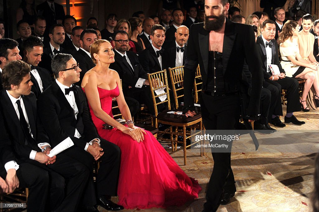 Actor Paul Wesley, Jason Weinberg and actress Uma Thurman watch the runway show during the 4th Annual amfAR Inspiration Gala New York at The Plaza Hotel on June 13, 2013 in New York City.