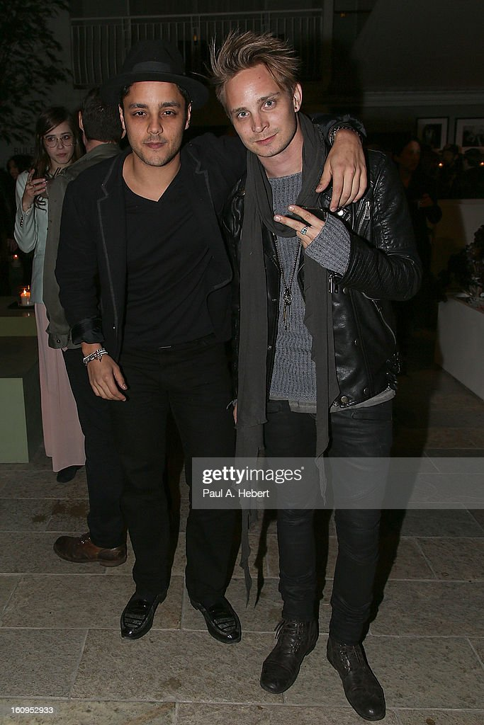 Actor Penn Badgley (L) and guest attend The Morrison Hotel Gallery Opening At The Sunset Marquis on February 7, 2013 in West Hollywood, California.