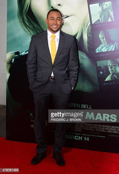 Actor Percy Daggs III poses on arrival for the film premiere of 'Veronica Mars' in Hollywood California on March 12 2014 The film opens on March 14...
