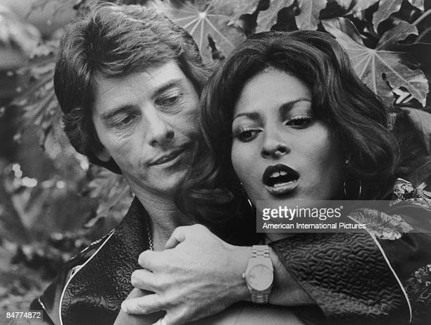 Actor Peter Brown tangles with actress Pam Grier who plays the titular character in the film 'Foxy Brown' 1974
