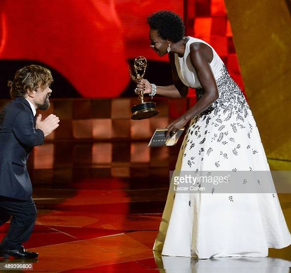 Actor Peter Dinklage accepts an award from actress Viola Davis onstage during the 67th Annual Primetime Emmy Awards at Microsoft Theater on September...