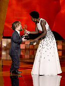 Actor Peter Dinklage accepts Outstanding Supporting Actor in a Drama Series award for 'Game of Thrones' from actress Viola Davis onstage during the...