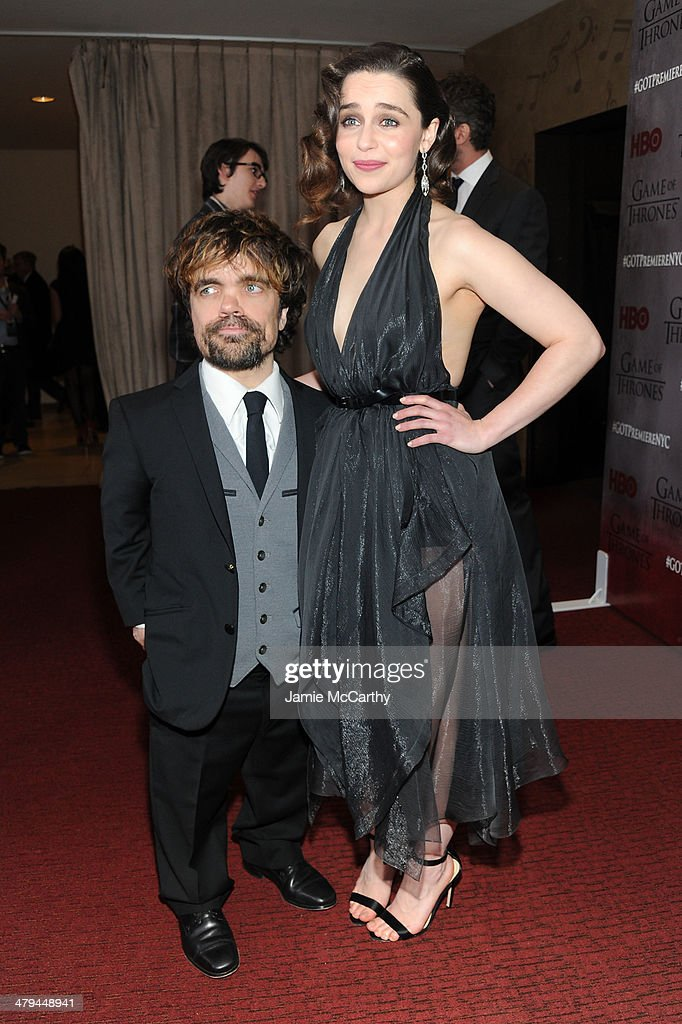 Actor <a gi-track='captionPersonalityLinkClicked' href=/galleries/search?phrase=Peter+Dinklage&family=editorial&specificpeople=215147 ng-click='$event.stopPropagation()'>Peter Dinklage</a> and actress <a gi-track='captionPersonalityLinkClicked' href=/galleries/search?phrase=Emilia+Clarke&family=editorial&specificpeople=7426687 ng-click='$event.stopPropagation()'>Emilia Clarke</a> attend the 'Game Of Thrones' Season 4 New York premiere at Avery Fisher Hall, Lincoln Center on March 18, 2014 in New York City.