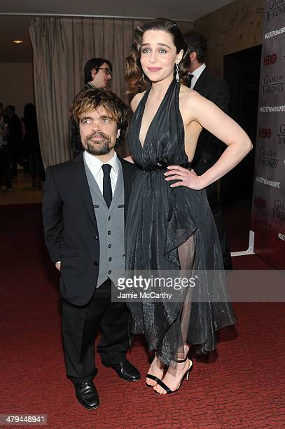 Actor Peter Dinklage and actress Emilia Clarke attend the 'Game Of Thrones' Season 4 New York premiere at Avery Fisher Hall Lincoln Center on March...
