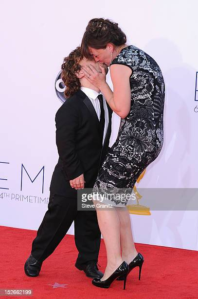 Actor Peter Dinklage and Erica Schmidt arrive at the 64th Primetime Emmy Awards at Nokia Theatre LA Live on September 23 2012 in Los Angeles...