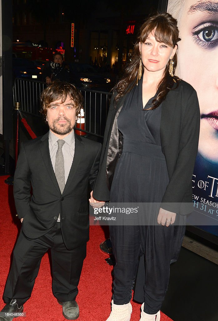 Actor <a gi-track='captionPersonalityLinkClicked' href=/galleries/search?phrase=Peter+Dinklage&family=editorial&specificpeople=215147 ng-click='$event.stopPropagation()'>Peter Dinklage</a> (L) and <a gi-track='captionPersonalityLinkClicked' href=/galleries/search?phrase=Erica+Schmidt&family=editorial&specificpeople=5085352 ng-click='$event.stopPropagation()'>Erica Schmidt</a> arrives to HBO's 'Game Of Thrones' Los Angeles Premiere at TCL Chinese Theatre on March 18, 2013 in Hollywood, California.
