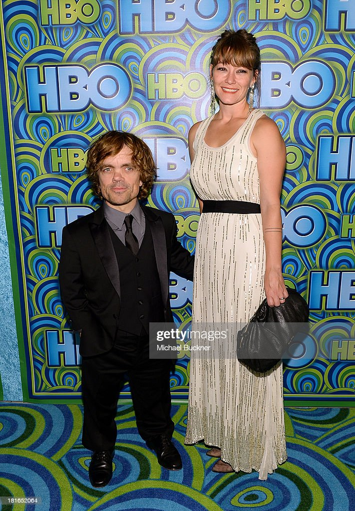 Actor Peter Dinklage (L) and Erica Schmidt attend HBO's Annual Primetime Emmy Awards Post Award Reception at The Plaza at the Pacific Design Center on September 22, 2013 in Los Angeles, California.