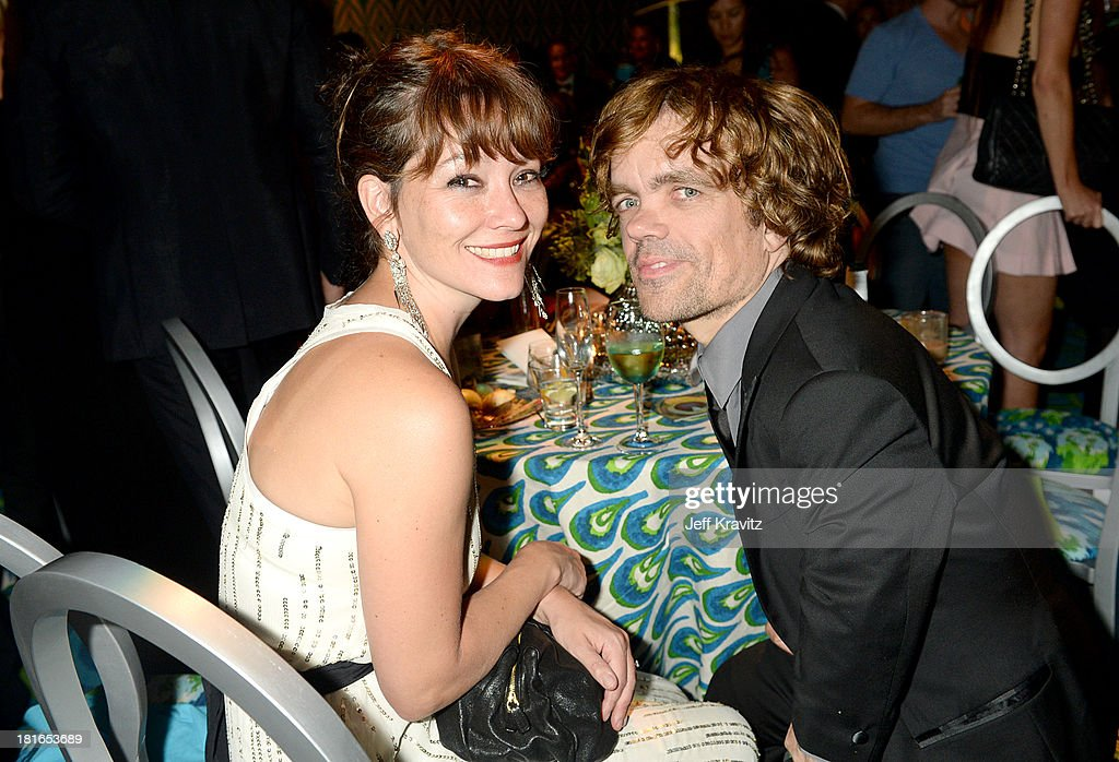 Actor <a gi-track='captionPersonalityLinkClicked' href=/galleries/search?phrase=Peter+Dinklage&family=editorial&specificpeople=215147 ng-click='$event.stopPropagation()'>Peter Dinklage</a> (R) and <a gi-track='captionPersonalityLinkClicked' href=/galleries/search?phrase=Erica+Schmidt&family=editorial&specificpeople=5085352 ng-click='$event.stopPropagation()'>Erica Schmidt</a> attend HBO's official Emmy after party at The Plaza at the Pacific Design Center on September 22, 2013 in Los Angeles, California.