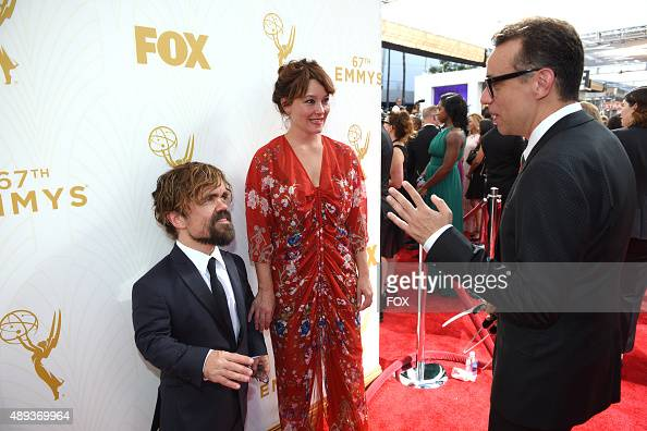 Actor Peter Dinklage Erica Schmidt and Fred Armisen attend the 67th Annual Primetime Emmy Awards at Microsoft Theater on September 20 2015 in Los...