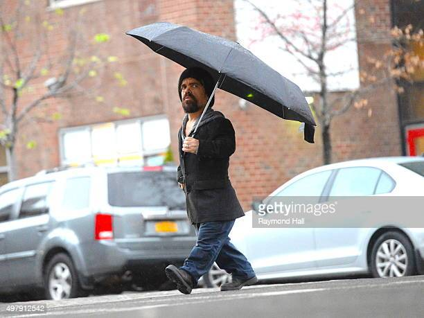 Actor Peter Dinklage is seen walking in the rain in Soho on November 19 2015 in New York City