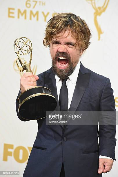 Actor Peter Dinklage poses with an Emmy award in the press room at the 67th Annual Primetime Emmy Awards at Microsoft Theater on September 20 2015 in...