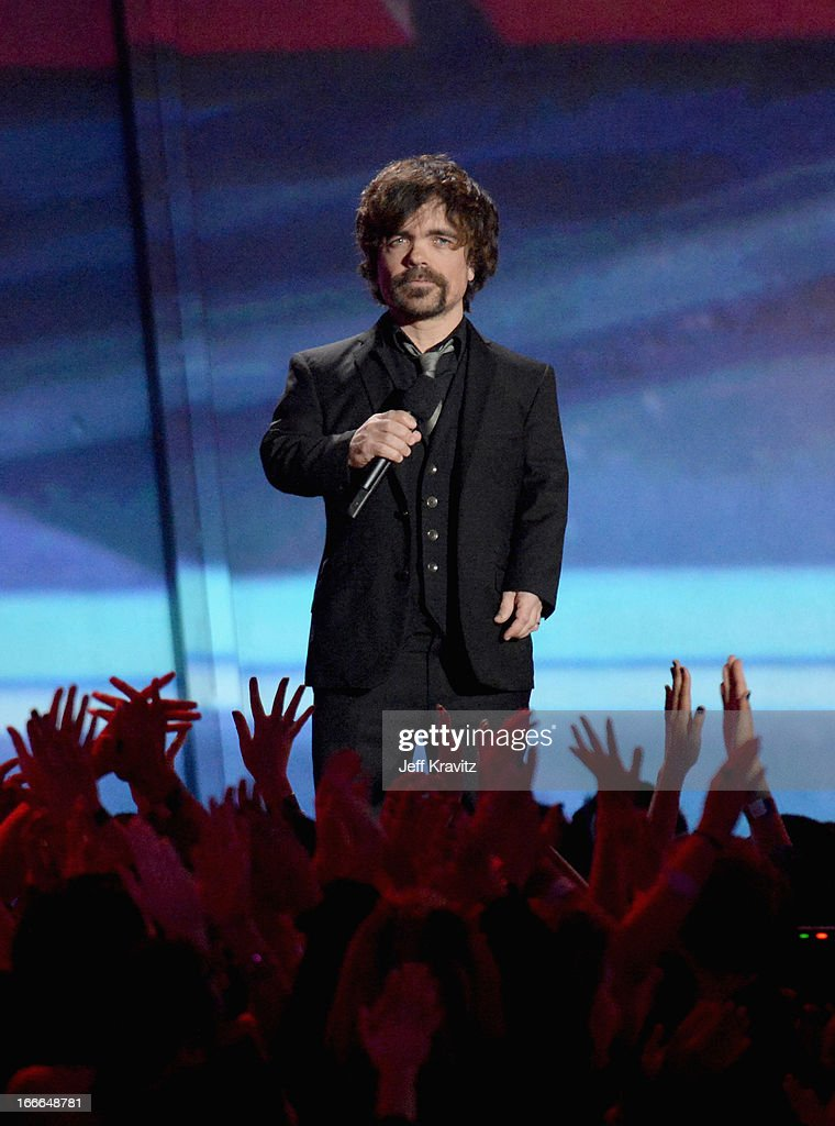Actor <a gi-track='captionPersonalityLinkClicked' href=/galleries/search?phrase=Peter+Dinklage&family=editorial&specificpeople=215147 ng-click='$event.stopPropagation()'>Peter Dinklage</a> speaks onstage during the 2013 MTV Movie Awards at Sony Pictures Studios on April 14, 2013 in Culver City, California.
