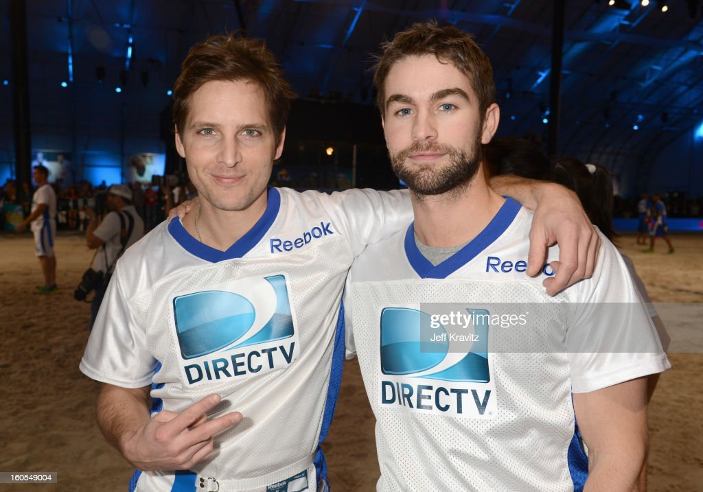 Actor Peter Facinelli (L) and actor Chace Crawford attend DIRECTV'S 7th Annual Celebrity Beach Bowl at DTV SuperFan Stadium at Mardi Gras World on February 2, 2013 in New Orleans, Louisiana.