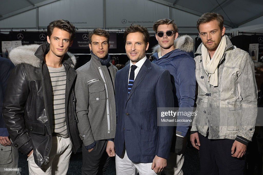 Actor <a gi-track='captionPersonalityLinkClicked' href=/galleries/search?phrase=Peter+Facinelli&family=editorial&specificpeople=233464 ng-click='$event.stopPropagation()'>Peter Facinelli</a> (C) poses backstage at the Nautica Men's Fall 2013 fashion show during Mercedes-Benz Fashion Week at The Stage at Lincoln Center on February 8, 2013 in New York City.