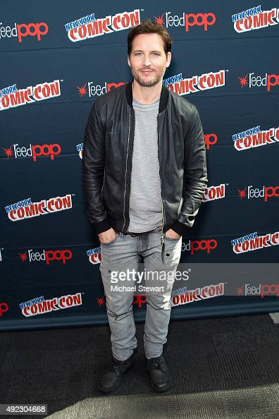 Actor Peter Facinelli poses in the press room for the 'Supergirl' panel during Comic Con Day 4 at The Jacob K Javits Convention Center on October 11...