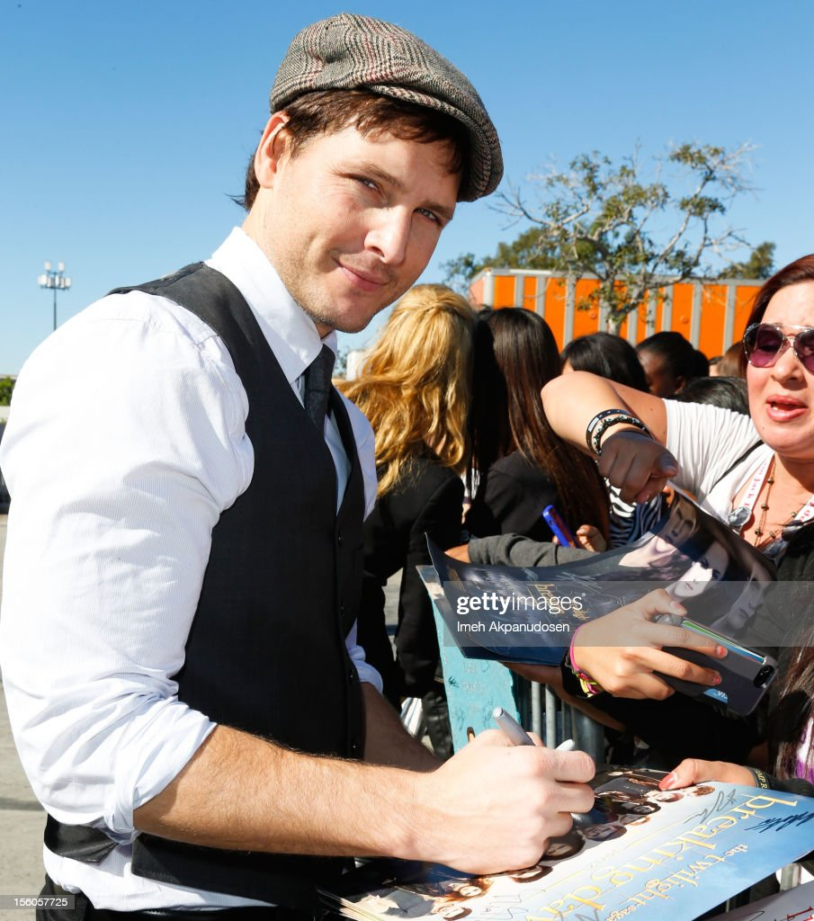 Actor <a gi-track='captionPersonalityLinkClicked' href=/galleries/search?phrase=Peter+Facinelli&family=editorial&specificpeople=233464 ng-click='$event.stopPropagation()'>Peter Facinelli</a> signs autographs at the 'Twilight Saga: Breaking Dawn Part 2' Fan Camp held at L.A. LIVE on November 11, 2012 in Los Angeles, California.